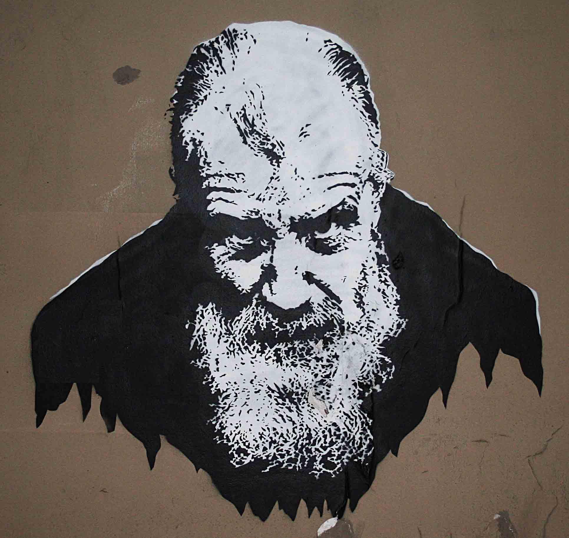 fresques et pochoir d'un vieillard à Paris